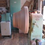 Walnut pedestal in lathe